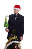 Verraste Zakenman met Kerstmisboom Stock Afbeelding