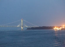 Verrazano Bridge and Freighters at Night Royalty Free Stock Photos