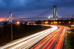 Verrazano Narrows Bridge above the light trails of the Belt Parkway traffic. Verrazano Narrows Bridge above the light trails of the Belt Parkway traffic on an stock image