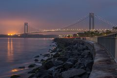 Verrazano-Narrows bridge in Brooklyn, NYC in the dusk. With cloudy weather royalty free stock images