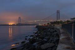 Verrazano-Narrows bridge in Brooklyn, NYC in the dusk. With cloudy weather stock images