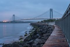 Verrazano-Narrows bridge in Brooklyn, NYC in the evening. Verrazano-Narrows bridge in Brooklyn, NYC in the cloudy evening royalty free stock image