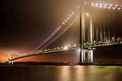 Verrazano-Narrows Bridge. Illuminated on a foggy night stock images