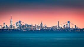 Verrazano Narrows Bridge and Manhattan skyline. Verrazano Narrows Bridge gates the access to Upper New York Bay. Manhattan skyline rises behind the bridge stock photos