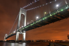 Verrazano Narrows Bridge at Night. From Brooklyn. The bridge a double-decked suspension bridge that connects the boroughs of Staten Island and Brooklyn in New royalty free stock image