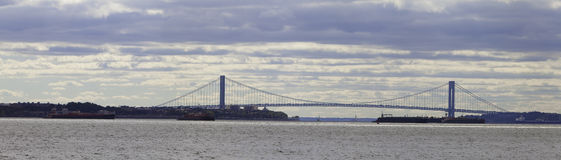 The Verrazano-Narrows Bridge Panorama. The Verrazano-Narrows Bridge is a double-decked suspension bridge that connects the boroughs of Staten Island and Brooklyn Royalty Free Stock Photography