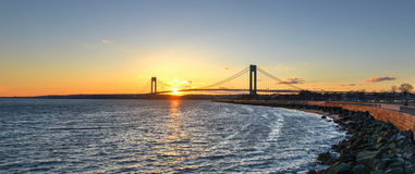Verrazano Narrows Bridge At Sunset. From Brooklyn. The bridge a double-decked suspension bridge that connects the boroughs of Staten Island and Brooklyn in New royalty free stock photos