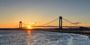 Verrazano Narrows Bridge At Sunset. From Brooklyn. The bridge a double-decked suspension bridge that connects the boroughs of Staten Island and Brooklyn in New royalty free stock photo