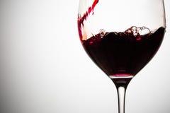 Verre à moitié plein de vin rouge Image stock