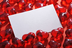 Verre-coeurs rouges image stock