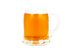 Verre de bière sur le blanc Photographie stock libre de droits