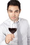 Verre de Holding Red Wine d'homme d'affaires Image stock