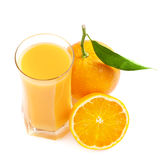 Verre de jus et fruit orange Photographie stock libre de droits
