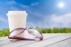 Verre de soleil de tasse de café Photos stock