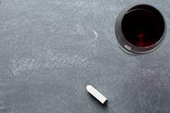 Verre de vin sur le tableau Photos stock