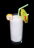 Verre sain de saveur de banane de smoothies sur le noir Images libres de droits