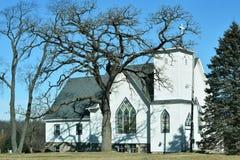 Verre souillé d'église blanche Images stock