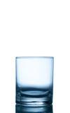 Verre vide pour le whiskey, l'eau, jus sur le blanc Images libres de droits