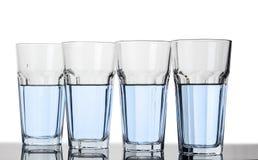 Verres avec de l'eau clair Photographie stock libre de droits