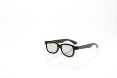 Verres 3d en plastique noirs avec du verre en plastique Photo stock