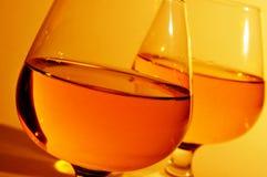 Verres de cognac avec l'eau-de-vie fine Images stock