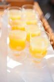 Verres de jus d'orange Photographie stock libre de droits