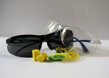 Verres de sûreté et prises d'oreille Image stock