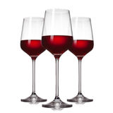 3 verres de vin rouge sur le blanc Photos stock