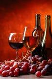 Verres et bouteilles de vin Photographie stock