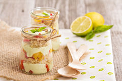 Verrine with quinoa, bell pepper and avocado Stock Image