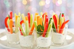 Verrines appetizer with carrot, cucumber, celery and red bell pepper sticks in glasses on platter at bokeh background,. View from above, close-up royalty free stock photos