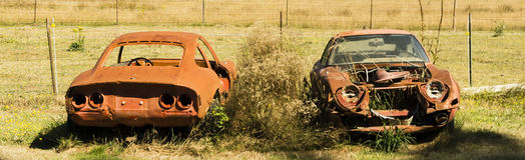 Verrostende alte Autos Stockfotos