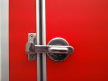 Verrou de porte de toilette au sol rouge lumineux Photos libres de droits