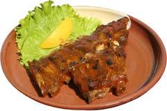 Vers die varkensvleeslapje vlees op barbecue met saus wordt geroosterd Stock Fotografie