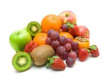 Vers fruit op een wit close-up als achtergrond. Royalty-vrije Stock Afbeeldingen