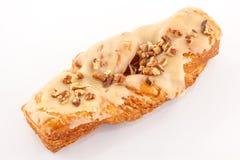 Vers gebakje met suikerglazuur en noten Stock Fotografie
