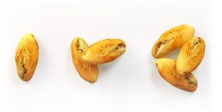 Vers gebakken broodjes geplaatst geïsoleerd Stock Afbeeldingen