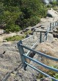 Vers le bas étapes de colline Photos stock
