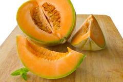 Vers le haut découpé en tranches melo de cantaloup Photos stock