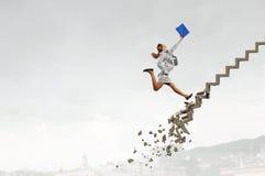 Vers le haut de l'échelle de carrière surmontant des défis Photographie stock