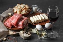 Vers ruw vlees, eieren, boter op zwarte houten lijst royalty-vrije stock foto's