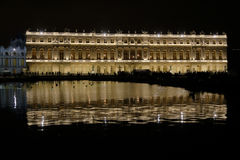 VERSAILLE FRANCE:  Chateau de Versailles at night with fountain and lights,  the estate of Versaille was the home and court of Lou Stock Image