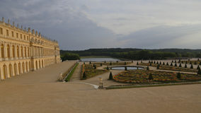 VERSAILLE FRANCE:  Chateau de Versailles at sunset with fountain,  the estate of Versaille was the home and court of Louis XIV, Fr Royalty Free Stock Photos