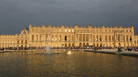 VERSAILLE FRANCE:  Chateau de Versailles at sunset with pond and fountain,  the estate of Versaille was the home and court of Loui Stock Photo