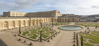 Versaille palace in France. Versaille, France - December 30, 2012: Panorama of Versaille palace and its garden with a pond on December 30, 2012 in Versaille Stock Photo