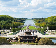 Versailles Castle gardens with fountain & tourists Stock Photos