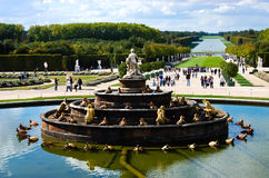 Versailles Castle gardens with fountain & tourists in France Royalty Free Stock Image