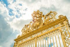 Versailles chateau. France. View of golden gate to palace. Royal Royalty Free Stock Images