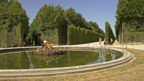 VERSAILLES, FRANCE - APRIL 2019: Circle shooting of basin of Saturn in Versailles gardens in France
