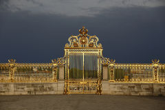 VERSAILLES, FRANCE - August 8, 2015: Main golden gates of the chateau de Versailles, Versailles, France. Stock Photography